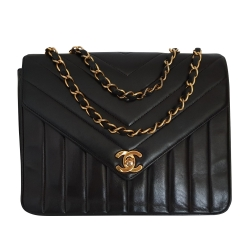 Chanel Classic 2.55 Vertical Single Flap.
