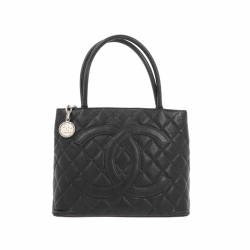 Chanel Medallion Tote bag in caviar leather.