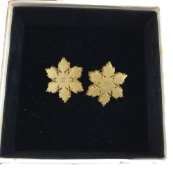 Chanel Snowflake Earrings with CC logo