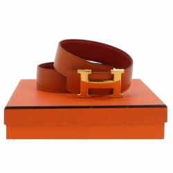 Hermès H belt in orange and red leather.