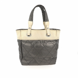 Chanel Shoulder bag in silver and beige fabric.