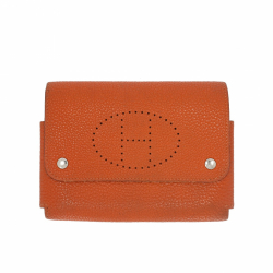 Hermès Pouch in orange leather.