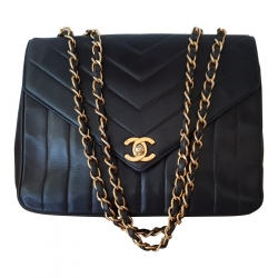 Chanel Rare Vintage Chanel Chevron Quilt classic with gold Hardware.